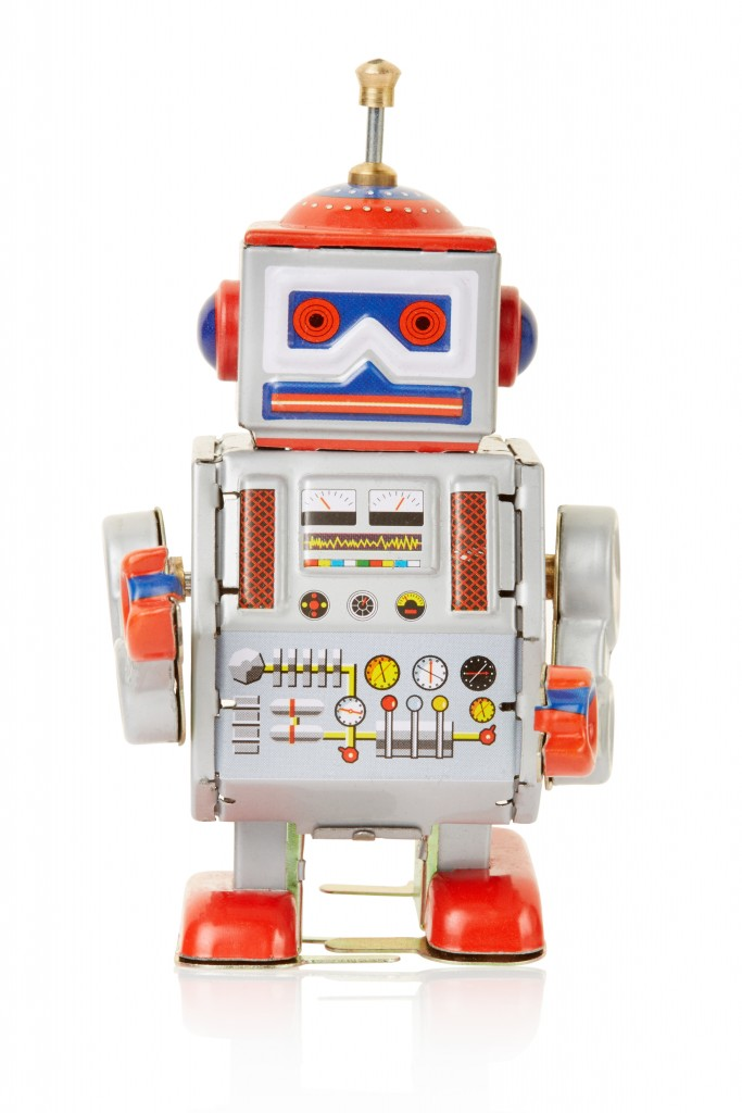 Robot vintage toy isolated on white, clipping path included
