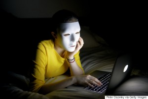 Anonymous teenager in mask on internet at night